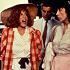 Bette Midler, Lily Tomlin, and Michele Placido in Big Business (1988)