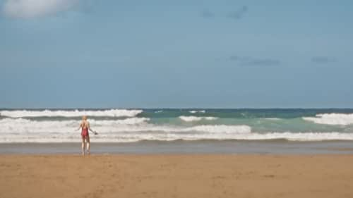 A Time Portal in the Sands Brings a Young Couple Together  As NATE, in his mid-twenties, sunbathes on a deserted beach while he waits for the surf, the singing sands alert him to a change in the environment.  Through his squinting eyes, he discovers HATTIE, a year younger, but dressed in a 1920s bathing suit, who has inexplicably appeared on the beach.  In contrast to the bewilderment of Nate, Hattie is clearly accustomed to her travels, and her wondrous nature fascinates him.  Nate is determined to discover who this beautiful time traveller is, as their worlds converge across the sands of time.