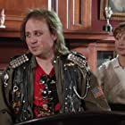 Bobcat Goldthwait and Corinne Bohrer in Police Academy 4: Citizens on Patrol (1987)