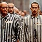 Willem Dafoe and Robert Loggia in Triumph of the Spirit (1989)