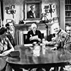 George Cole, Fay Compton, Guy Middleton, and Alastair Sim in Laughter in Paradise (1951)