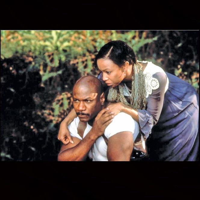 Ving Rhames and Elise Neal in Rosewood (1997)