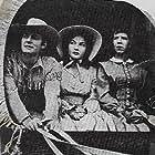 Lynn Bari, Jon Hall, and Renie Riano in Kit Carson (1940)