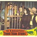 John Wayne, Roscoe Ates, Ray Corrigan, Carole Landis, and Max Terhune in Three Texas Steers (1939)