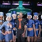 Bruce Willis, Natasha Brice, Sophia Goth, Genevieve Maylam, Stacey McKenzie, Nicole Merry, Indra Ové, Josie Perez, and Rachel Willis in The Fifth Element (1997)
