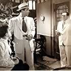 Thomas Gomez and Fred MacMurray in Singapore (1947)