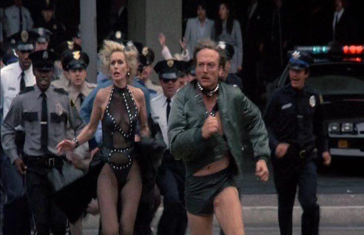 Sally Kellerman and James Keach in Moving Violations (1985)