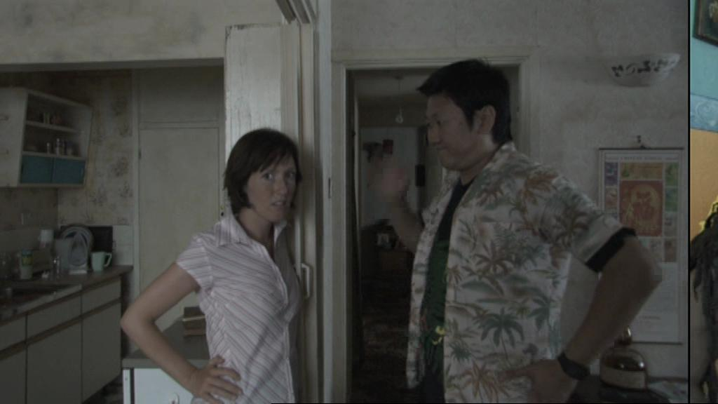 Benedict Wong and Hannah Jane Fox in 15 Storeys High (2002)