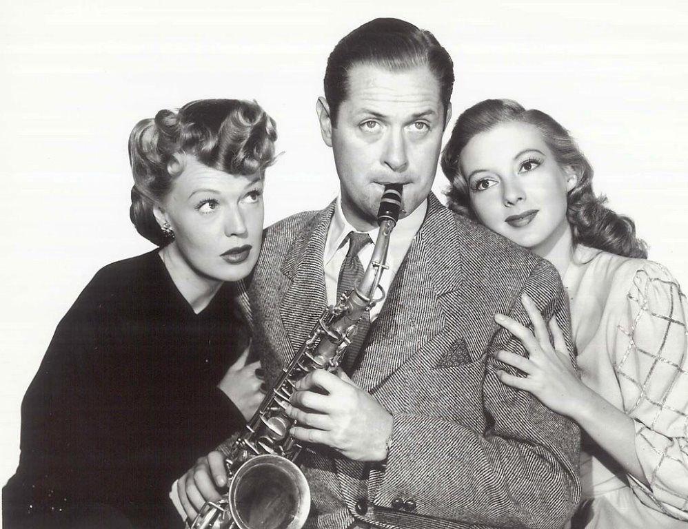 Rita Johnson Evelyn Keyes and Robert Montgomery in Here Comes Mr Jordan 1941