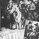 Tim McCoy, Lou Fulton, and Julian Rivero in Arizona Gang Busters (1940)