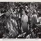 John Wayne, Beulah Bondi, Angelo Cruz, Paul Fix, Alex Havier, Joseph Kim, and Tommy Estrella in Back to Bataan (1945)
