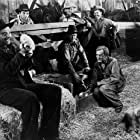 Lon Chaney Jr., Charles Bickford, Granville Bates, Roman Bohnen, and Burgess Meredith in Of Mice and Men (1939)