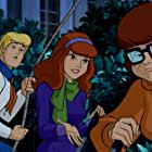 Mindy Cohn, Grey Griffin, and Frank Welker in Scooby-Doo! Mask of the Blue Falcon (2012)