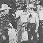 Evelyn Finley, John 'Dusty' King, David Sharpe, and Max Terhune in Trail Riders (1942)