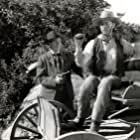 Kenne Duncan and Robert Kent in The Phantom Rider (1946)