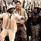 Pierce Brosnan and Maynard Eziashi in Mister Johnson (1990)