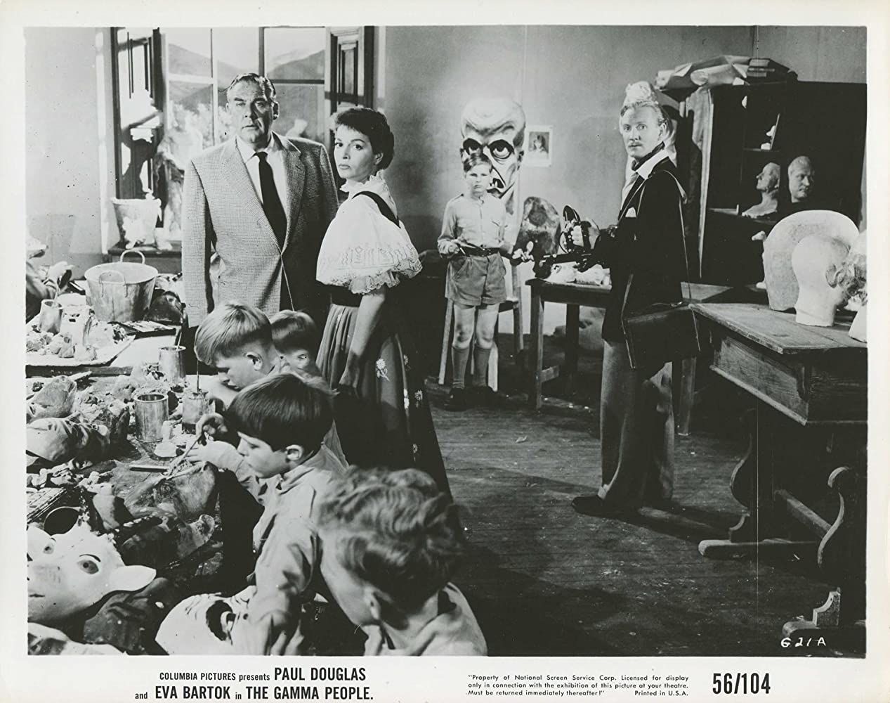 Paul Douglas and Eva Bartok in The Gamma People (1956)