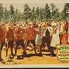 William Austin, Herbert Corthell, Earl Douglas, Donald Reed, Carol Hughes, Arthur Millett, and James Newill in Renfrew of the Royal Mounted (1937)
