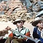 Piper Laurie, William Schallert, Douglas Spencer, and William Talman in Smoke Signal (1955)