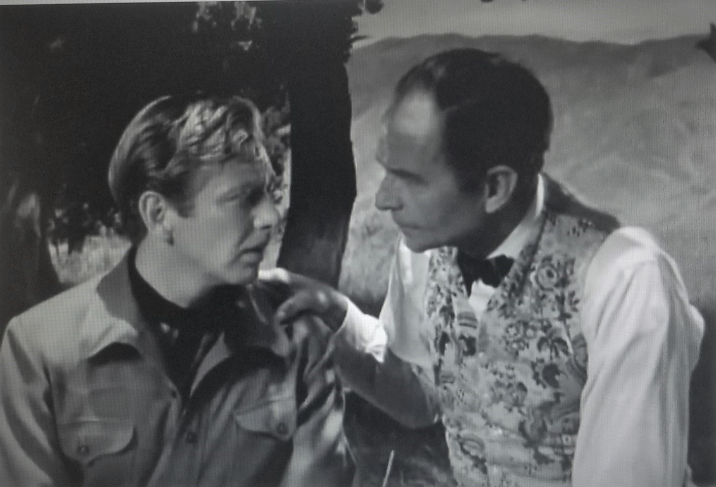 Rand Brooks and Earle Hodgins in Silent Conflict (1948)