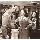 Roy Rogers, Dale Evans, and Estelita Rodriguez in Susanna Pass (1949)