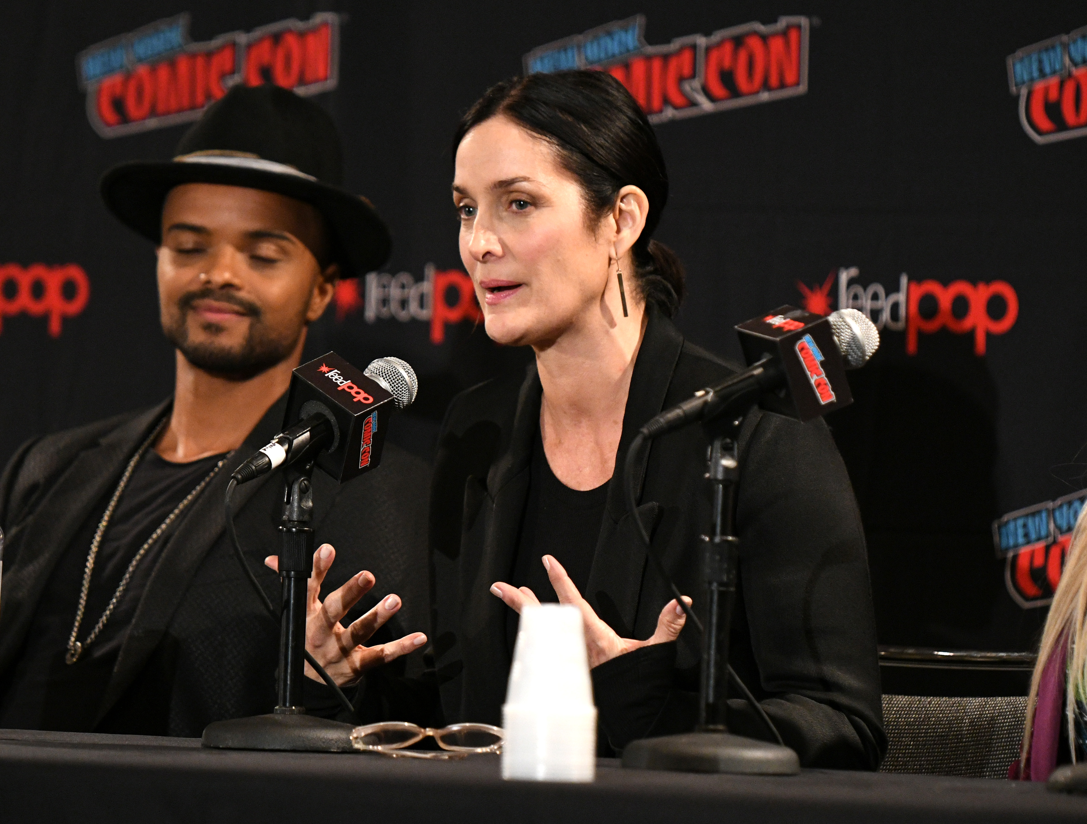 Carrie-Anne Moss and Eka Darville at an event for Tell Me a Story (2018)