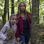 Dixie Egerickx andTallulah Evans in a still from THE WATCHER IN THE WOODS.