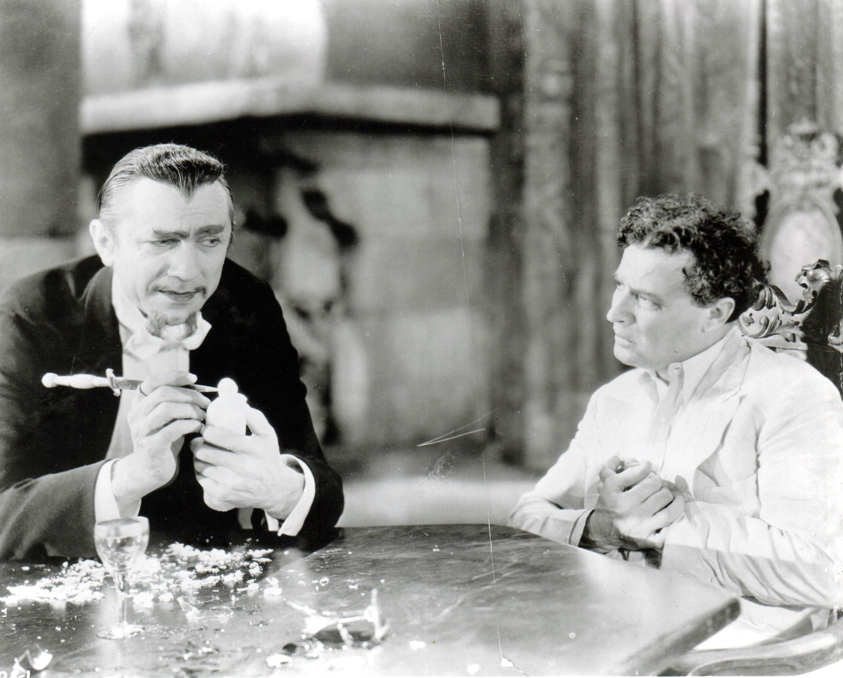 Bela Lugosi and Robert Frazer in White Zombie (1932)