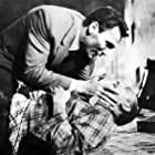 Donald Pleasence and Jack Palance in The Man Inside (1958)
