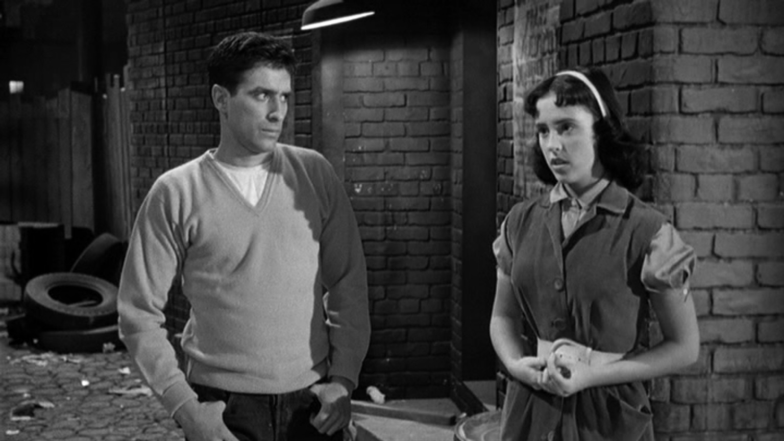 John Cassavetes and Denise Alexander in Crime in the Streets (1956)