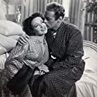 Linda Darnell and Rex Harrison in Unfaithfully Yours (1948)