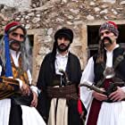 Theodoros Kolovos, Panagiotis Arvanitis, and Leonardo Thimo in Pou sai more Nikitara (2021)