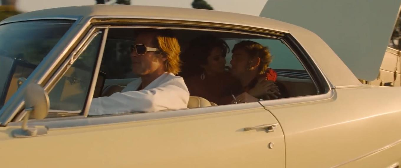 Brad Pitt, Leonardo DiCaprio, and Lorenza Izzo in Once Upon a Time... in Hollywood (2019)