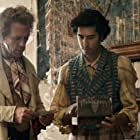 Hugh Laurie and Dev Patel in The Personal History of David Copperfield (2019)