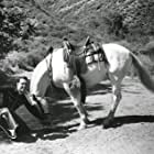 Reb Russell and Rebel in Fighting Through (1934)
