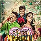 Namitha Pramod, Hareesh Kanaran, and Bibin George in Margamkali (2019)