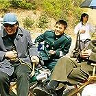 Lee Byung-hun, Park Chan-Wook, Shin Ha-kyun, and Kang-ho Song in Gongdong gyeongbi guyeok JSA (2000)