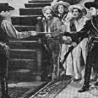 Don 'Red' Barry, Leander De Cordova, and Milburn Stone in The Phantom Cowboy (1941)