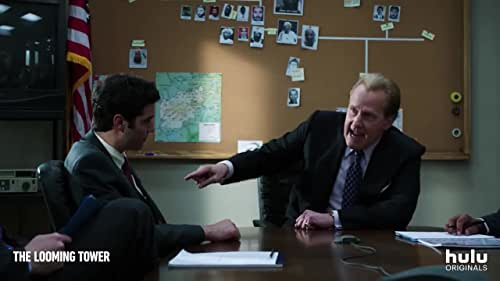 """""""The Looming Tower"""" traces the rising threat of Osama Bin Laden and Al-Qaeda in the late 1990s and how the rivalry between the FBI and CIA during that time may have inadvertently set the path for the tragedy of 9/11. The series follows members of the I-49 Squad in New York and Alec Station in Washington, D.C., the counter-terrorism divisions of the FBI and CIA, respectively, as they travel the world fighting for ownership of information while seemingly working toward the same goal - trying to prevent an imminent attack on U.S. soil."""