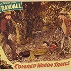 Budd Buster, Kenne Duncan, Jack Randall, and Glenn Strange in Covered Wagon Trails (1940)
