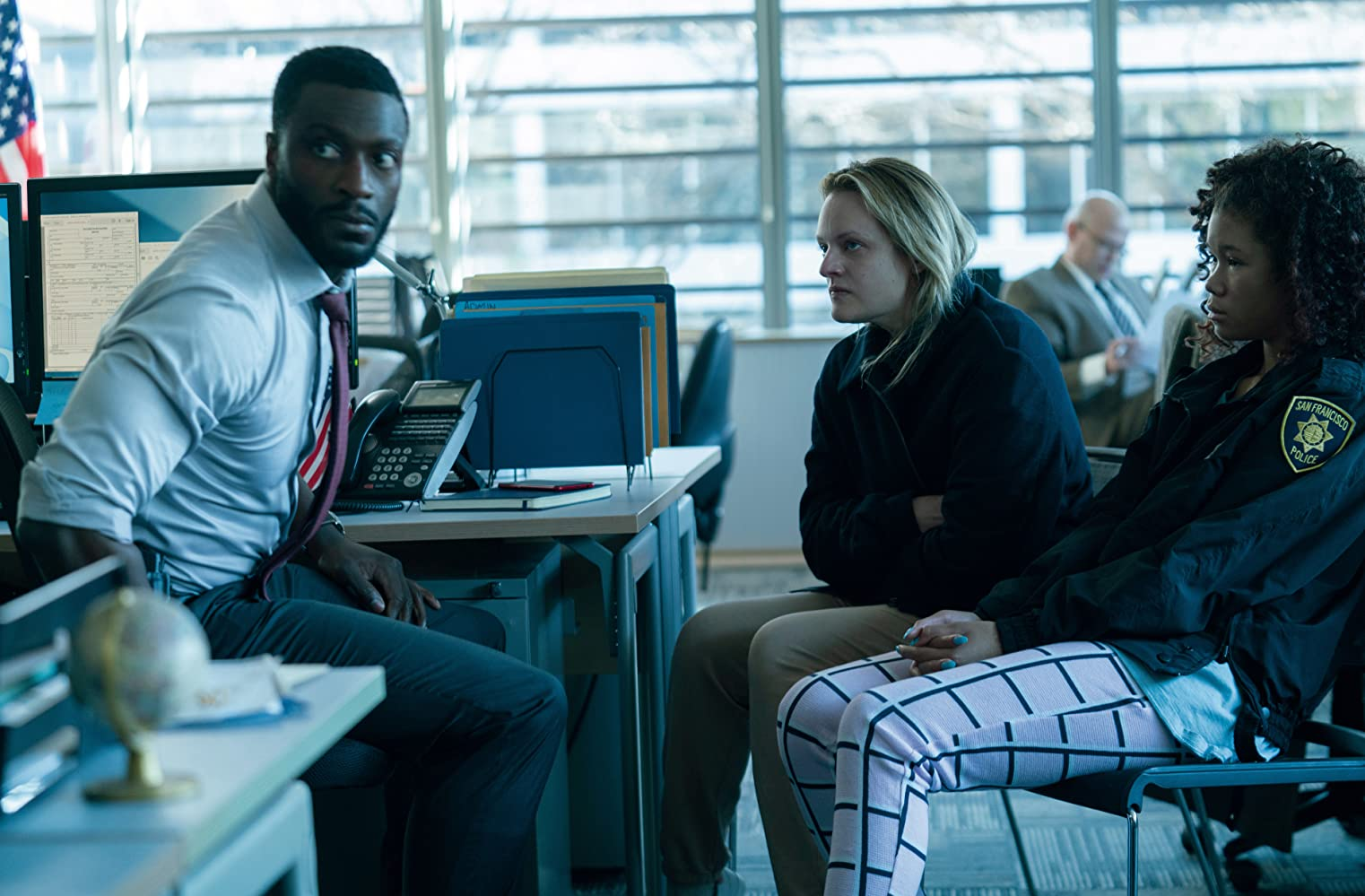 Elisabeth Moss, Aldis Hodge, and Storm Reid in The Invisible Man (2020)