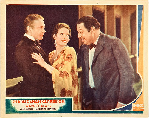 Marguerite Churchill, John Garrick, and Warner Oland in Charlie Chan Carries On (1931)