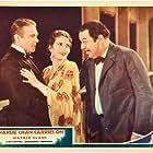 Marguerite Churchill, John Garrick, and Warner Oland in Charlie Chan Carries On (1931)