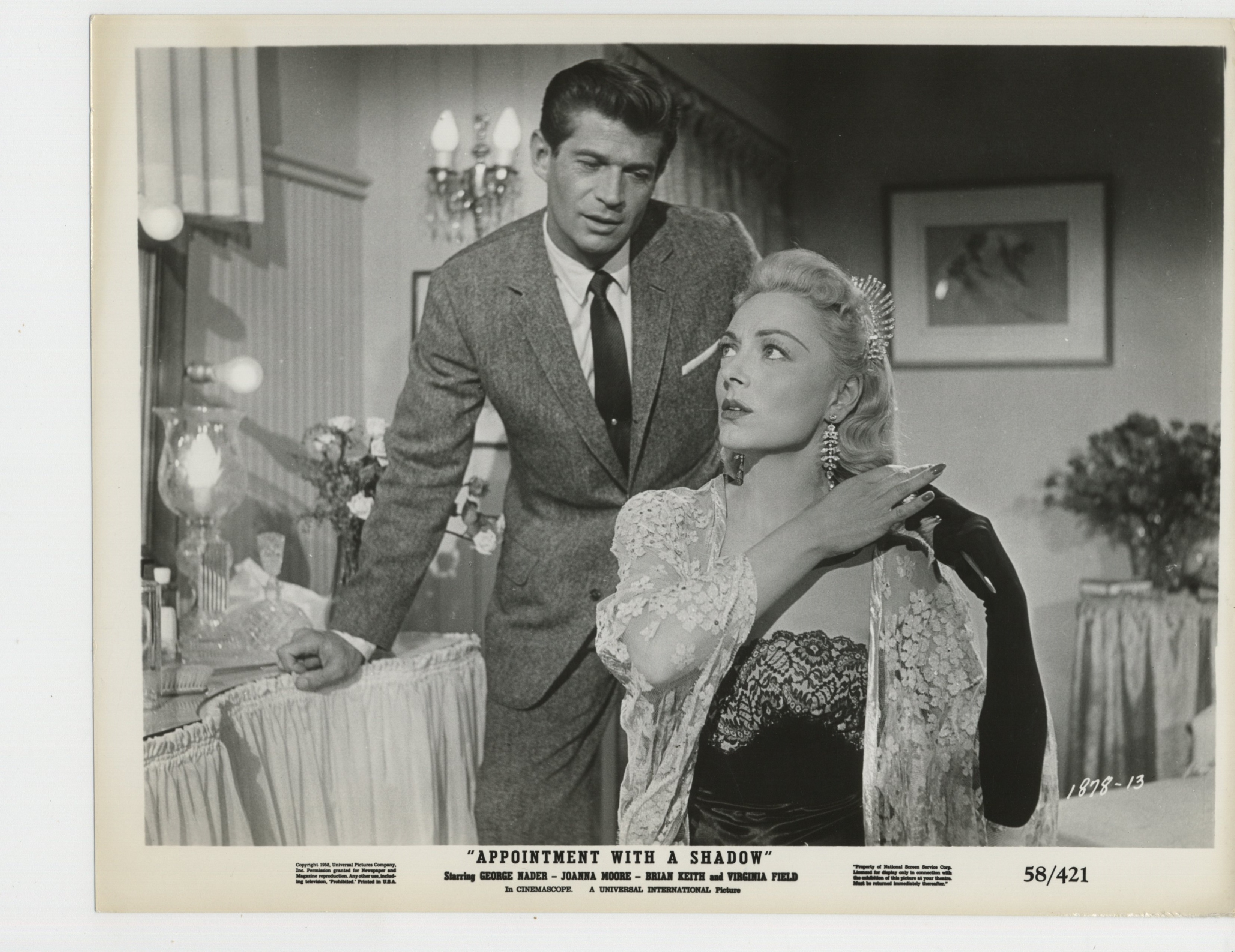 Virginia Field and George Nader in Appointment with a Shadow (1957)