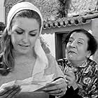 Tonia Kaziani and Sapfo Notara in 5.000 psemmata (1966)