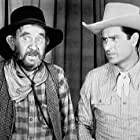 Lee 'Lasses' White and Ray Whitley in Riding the Wind (1942)