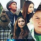 David DeLuise, Mary Lynn Rajskub, Nadine Velazquez, Daniel Jenks, Rowan Blanchard, Landry Bender, and Nathaniel J. Potvin in A World Away (2019)