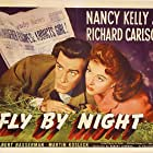 Richard Carlson and Nancy Kelly in Fly-By-Night (1942)
