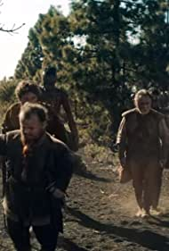 Henry Cavill, Ron Cook, Simeon Dyer, Joey Batey, Colette Dalal Tchantcho, Adesuwa Oni, and Jeremy Crawford in The Witcher (2019)