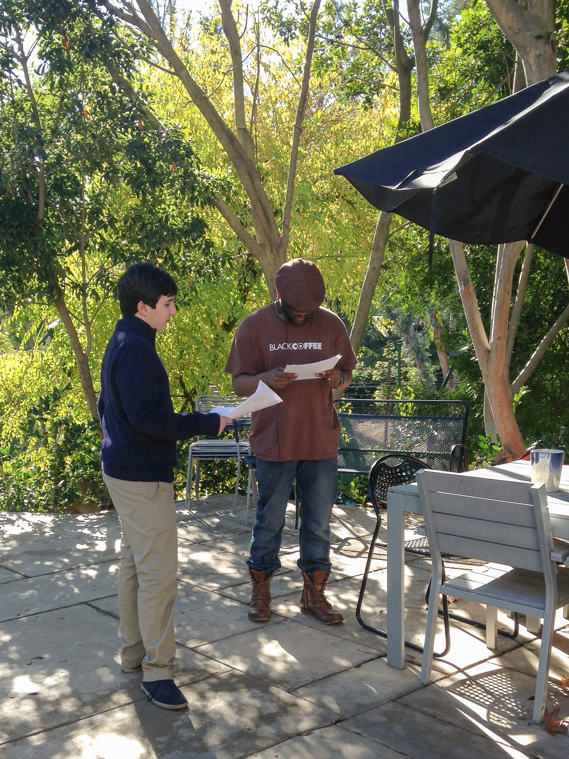 August Bagg and Mark Harris on set of No Regrets